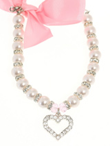 Pearl Heart Charm Dog Necklace - Pearls separated by a row of Swarovski Crystals make up this beautiful necklace. It is finished with a heart shaped pendant containing 24 Swarovski Crystals and comes complete with a pink bow for the back of the neck, so no matter what angle you view this necklace from it looks beautiful. (X-Small:...